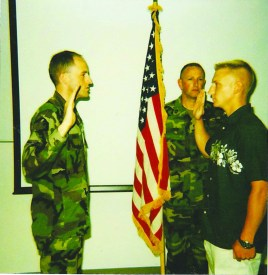 Photo Contributed by Tony Bryan Lieutenant Colonel Mark Weber (left) reenlists Tony Bryan (right). Bryan said Weber played a role in his decision to attend drill sergeant school.