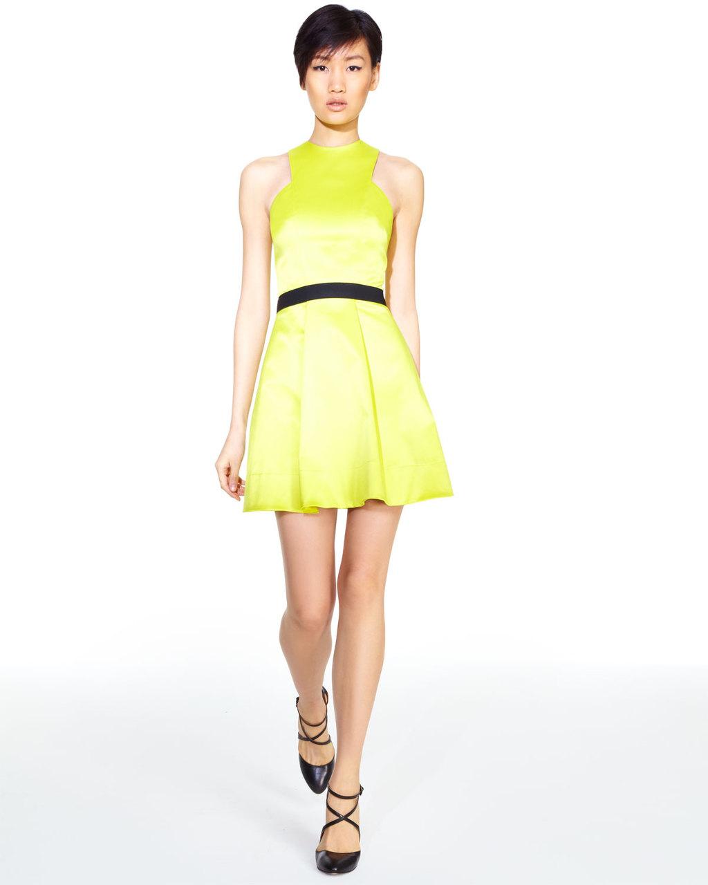 Electric yellow bridesmaid dress with black sash