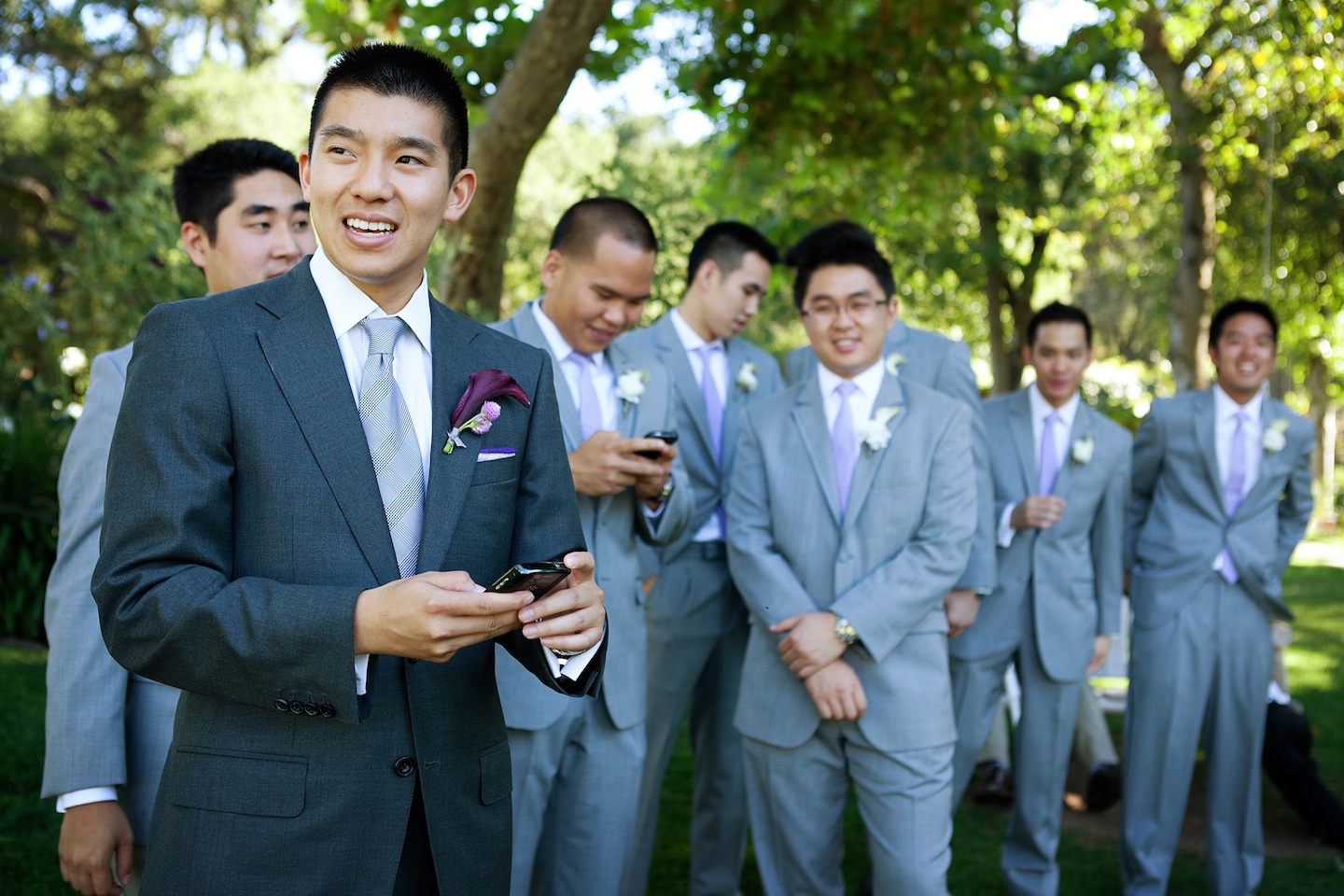 Groomsmen All In Grey Where Groom Still Stands Out