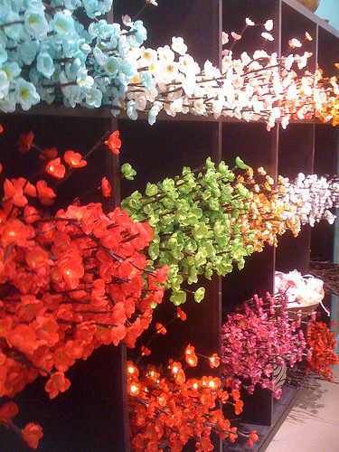 Lighted branches for flower arrangements in a variety of colors
