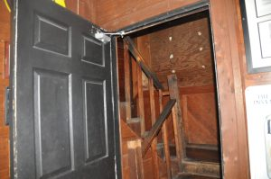 Stairs leading to the room where a 13-year-old victim's body was found.