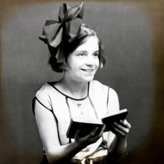 Young 1920s girl reading