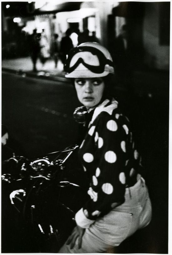 1960s fashion mod girl on a scooter
