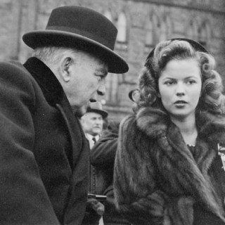 A teenage Shirley Temple in a fur coat