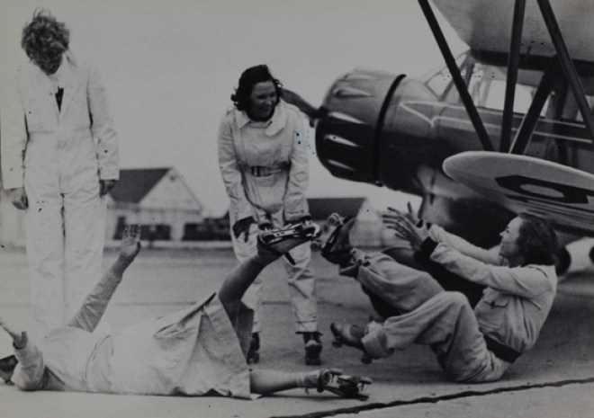 Amelia Earhart and chums roller skating (or trying to), 1930s