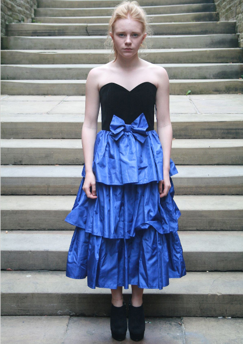 Strapless cocktail dress with velvet bodice and three layers of taffeta in the skirt.