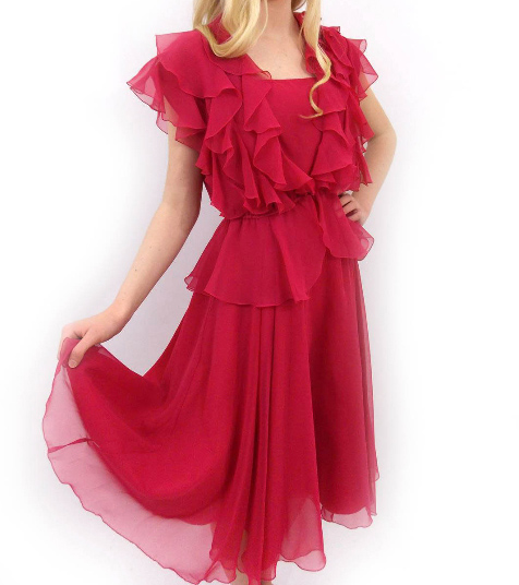 Pretty spaghetti strap dress with layered flouncy over blouse.