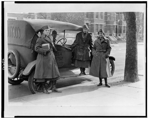 Women wearing trench coats 1919