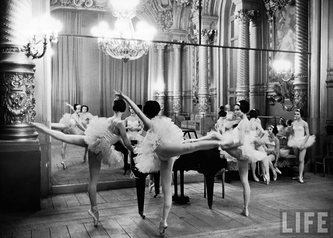 Ballerinas at the Paris Opera doing their barre in rehearsal room.