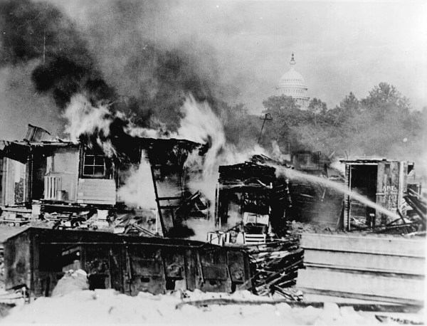 Shacks, put up by the Bonus Army on the Anacostia flats, Washington, DC, burning after the battle with the military, 1932