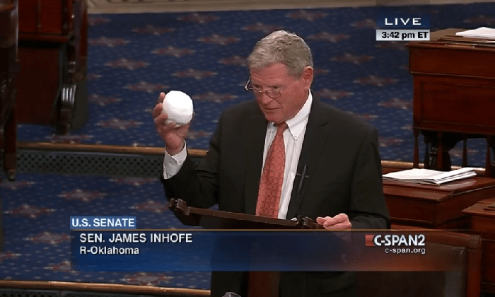 Sen. James Inhofe holding snowball