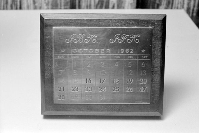 A silver-plated wooden paperweight calendar given to Jacqueline Kennedy from JFK to mark the Cuban Missile Crisis; Kennedy had 34 made by Tiffany and Co, each engraved with the recipient's and the President's initials