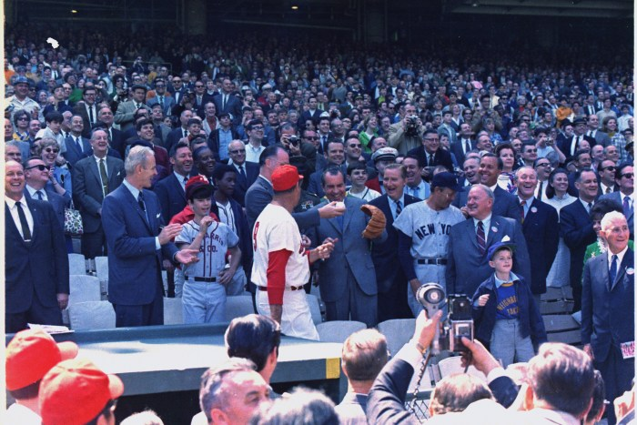 President Nixon throwing out the first ball on opening day of the 1969 baseball season between the Washington Senators and the New York Yankees