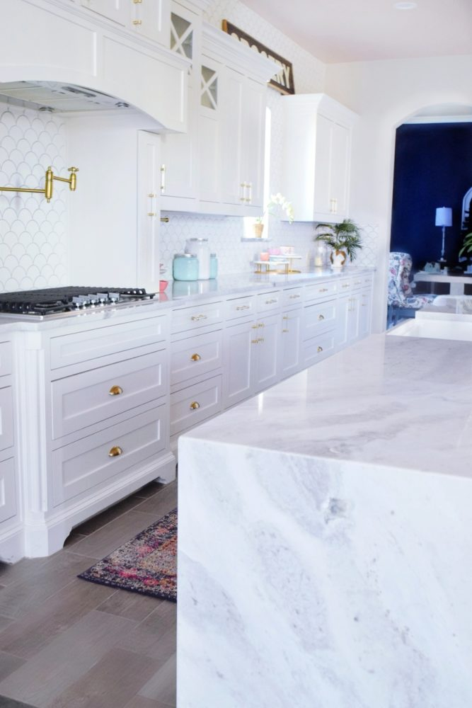 White Marble Island The Reveal Modern Coastal Glam Kitchen Makeover We Re The Joneses