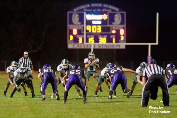 Photo by Dan Hockett West Burlington – Notre Dame Quarterback Drake Day (3) takes the hike early in the game against Keokuk Friday night in Keokuk. Keokuk defeated WBND, 24-21.