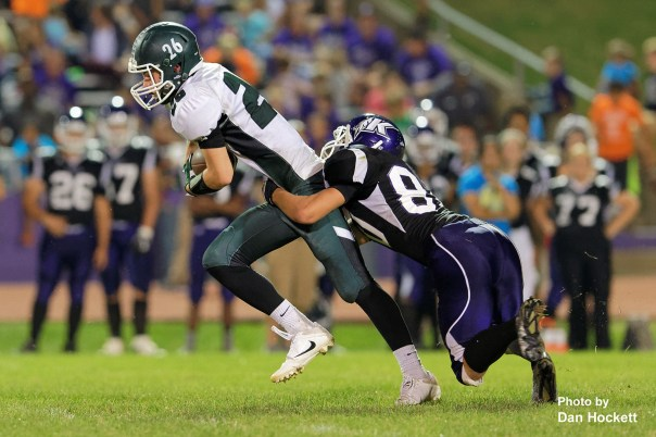 Photo by Dan Hockett West Burlington – Notre Dame Wide Receiver Tanner Snodgrass (26) is tackled in the backfield by Keokuk's Austin West (80) Friday night in Keokuk. Keokuk defeated WBND, 24-21.