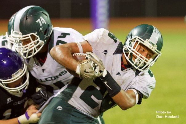 Photo by Dan Hockett West Burlington – Notre Dame Running Back Isaiah Trousil (28) fights to advance the ball Friday night in Keokuk. Keokuk defeated WBND, 24-21.