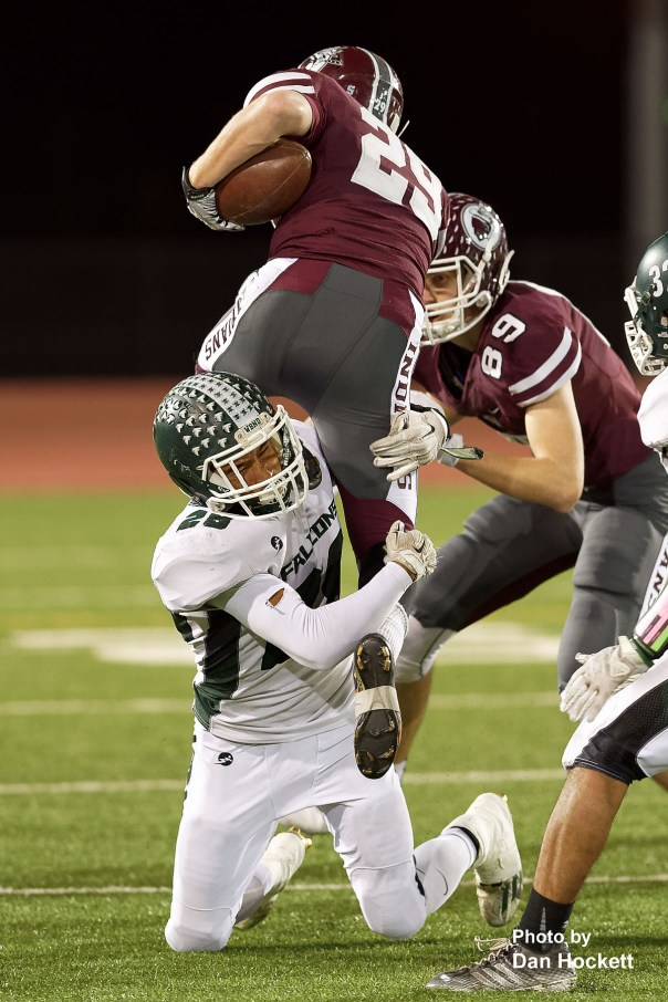 Photo by Dan Hockett West Burlington – Notre Dame's Isaiah Trousil (28) tackles Oskaloosa Running Back Blake Allsup (29) Friday night in Oskaloosa. Oskaloosa defeated West Burlington – Notre Dame, 47-6.