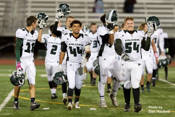 Photo by Dan Hockett West Burlington – Notre Dame Teammate salute the fans after their final game of the season Friday night in Oskaloosa. Oskaloosa defeated West Burlington – Notre Dame, 47-6.