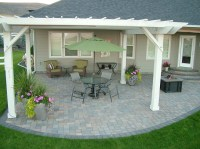 The open pergola gives this patio a sweeping view and ...