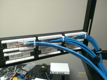Punching down into a patch panel is very similar to before except that there are several runs landing at a tighter location.   Plan ahead and secure everything down with zip-ties