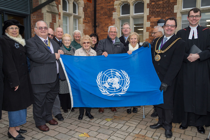Lions join the Mayor in raising the UN flag on UN Day