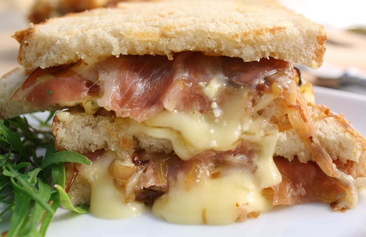 Brie and prosciutto Panini with fig jam and caramelized onions