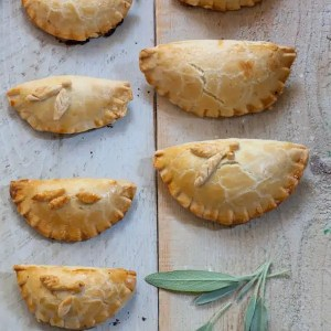 Savory Sausage, Apple and Sage Hand Pies in two different sizes.