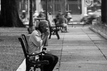 Man on park Bench in Ho Chi Minh City