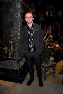 Simon Pegg by the Vanishing cabinet from Borgin and Burkes featured in the new Dark Arts area at the Warner Bros. Studio Tour London - The Making of Harry Potter open now