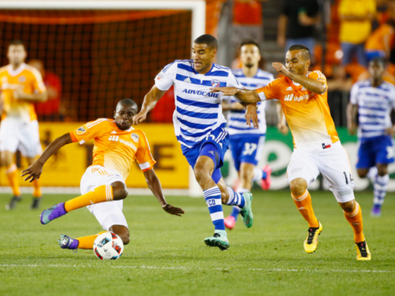 Boniek Garcia and Alex of the Houston Dynamo battle for the ball with Tesho Akindele of FC Dallas. (Scott Halleran/Getty Images North America)