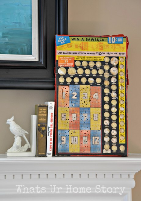 Simple spring mantel, vintage sawbuck game board, spring vignette