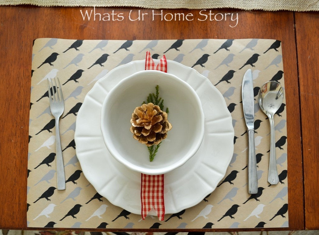holiday place setting with pine cones