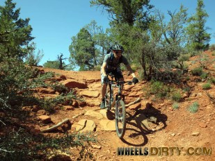 Brandon going down some chunky terrain on Llama trail.
