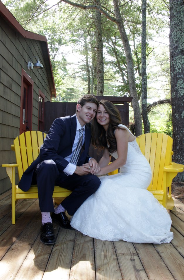 Natalie and Casey doing a one year anniversary photo shoot sitting on the chairs
