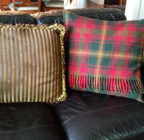 Old and new pillow after recovering old pillow with plaid blanket