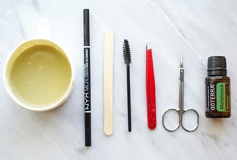 Supplies for waxing your eyebrows at home.