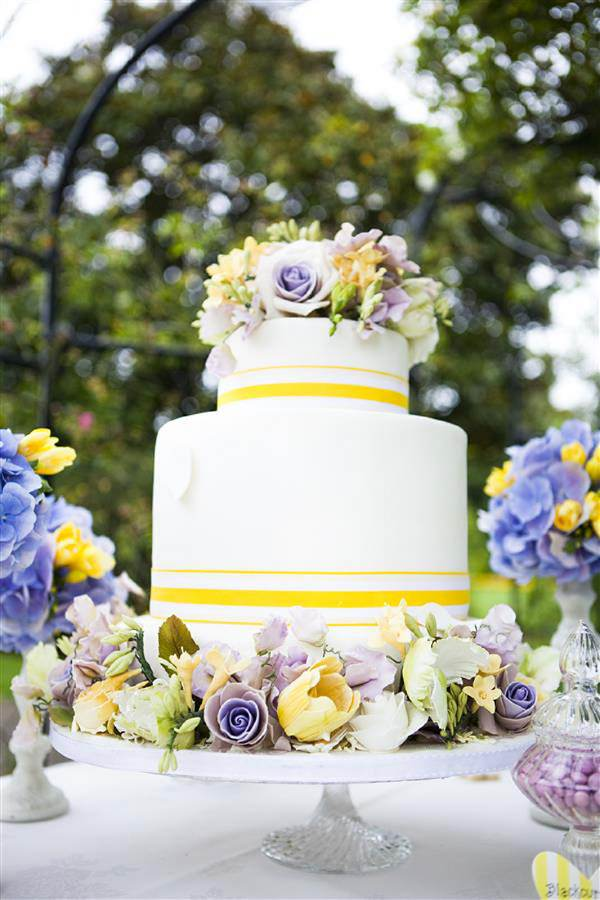 yellow purple wedding cake