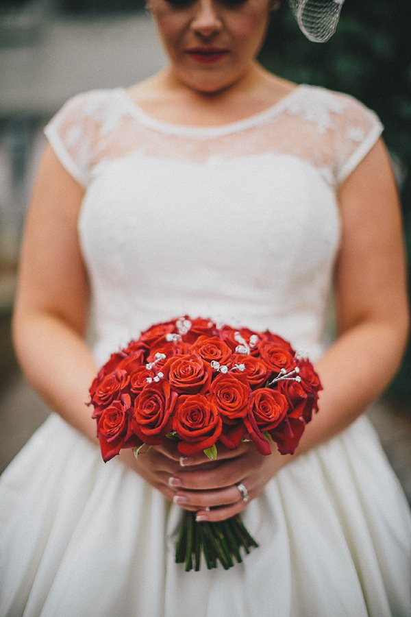 red rose bouquet wedding bride