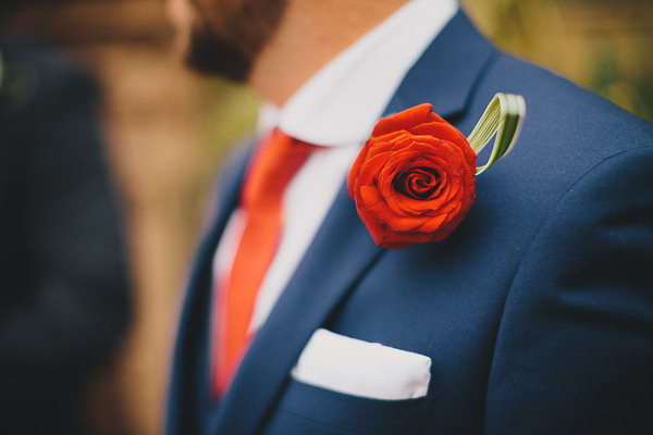 red rose buttonhole groom