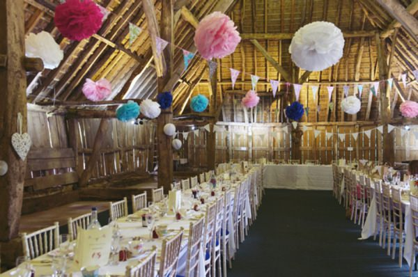 barn wedding pom poms bunting http://www.rebeccadouglas.co.uk/blog/