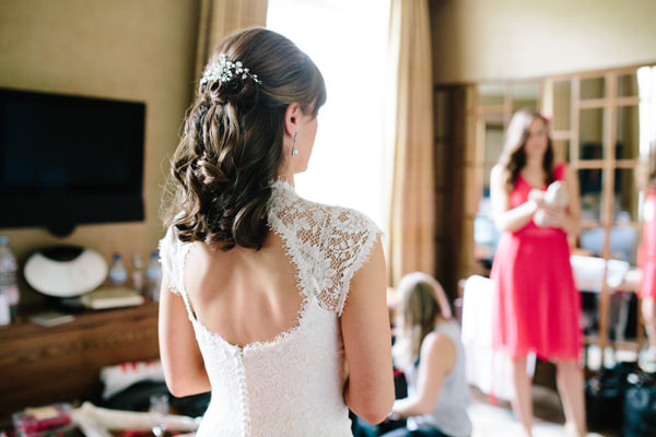 Stylish Rustic Coral Barn Wedding Lace Dress Back Bride  http://hayleysavagephotography.co.uk/