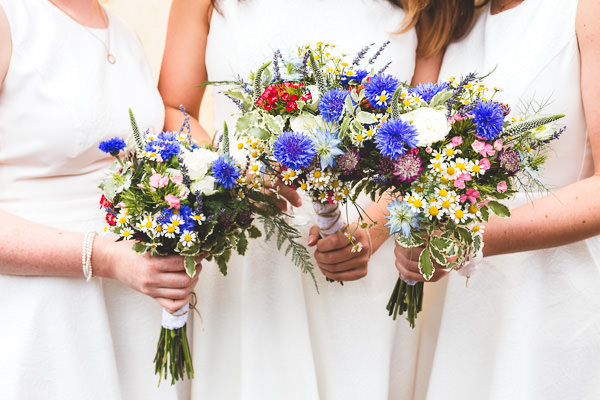 Colourful Garden Tipi Wedding Wild Flower Bouquets Bridesmaids http://www.jacksonandcophotography.com/