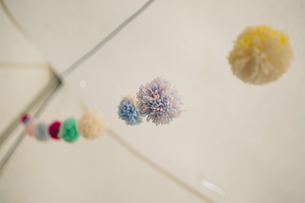 Quirky Campsite Outdoor Wedding Pom Pom Wool Garlands http://www.lifelinephotography.co.uk/