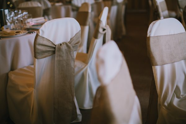 Stylish White DIY Floral Filled Barn Wedding Hessian Chairs http://www.chrisbarberphotography.co.uk/