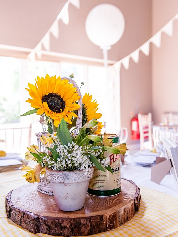Quirky Rustic Lemon Yellow Wedding Sunflowers Logs Table Centrepiece http://www.motifphoto.co.uk/