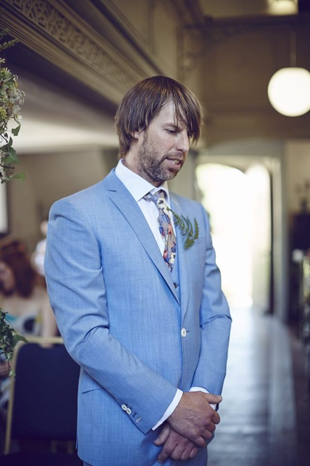 Blue Groom Suit Style Family Friendly DIY Village Hall Wedding http://www.novaweddingphotography.co.uk/