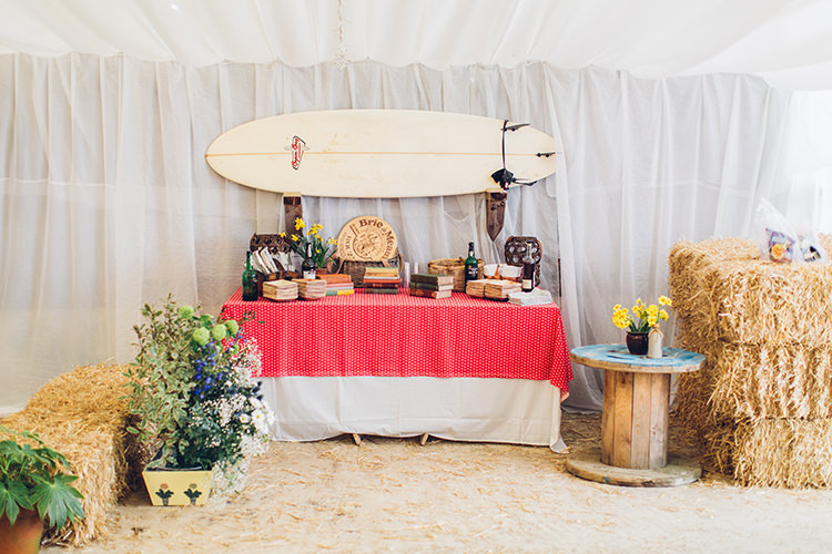 Barn Drapes Hay Bales Surf Board Chilled DIY Beach Front Cafe Cornwall Yellow Blue Wedding http://missgen.com/