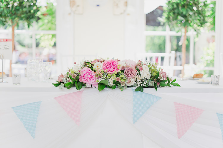 Top Table Flowers Bunting Tweed Bow Ties Fresh Country Pink Green Wedding http://www.whitestagweddings.com/