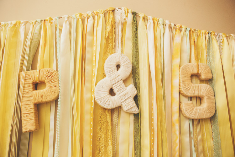 Ribbon Backdrop Letters Initials Quirky Relaxed Yellow Country Wedding http://www.mr-and-mrs-wedding-photography.co.uk/